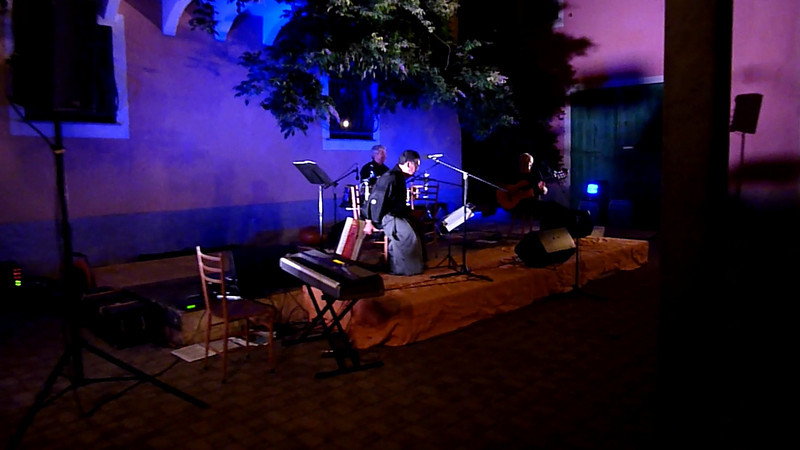 "Japanese flautist Hiroshi Konezawa, Italian guitarist Armando Corsi and percussionist Mario Fadda playing in Varese Ligure. The melody is ""Vecchio frack"" by Domenico Modugno."