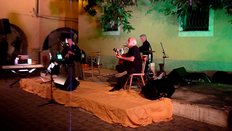 Japanese flautist Hiroshi Konezawa, Italian guitarist Armando Corsi and percussionist Mario Fadda playing in Varese Ligure