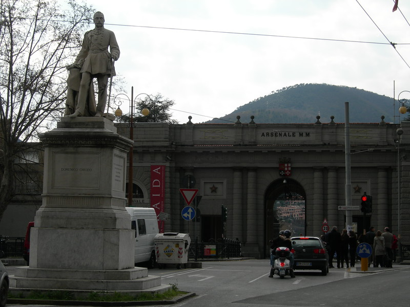 The entry to the Arsenal and the statue of Domenico Chiodo. Domenico Chiodo was the architect responsible for building the Arsenal; still today, the Arsenal is one of the most important industries in La Spezia and it occupies a huge area by the sea.<br /> <br /> L'ingresso all'Arsenale con la statua di Domenico Chiodo, l'ammiraglio responsabile della progettazione del porto di La Spezia sotto Cavour.