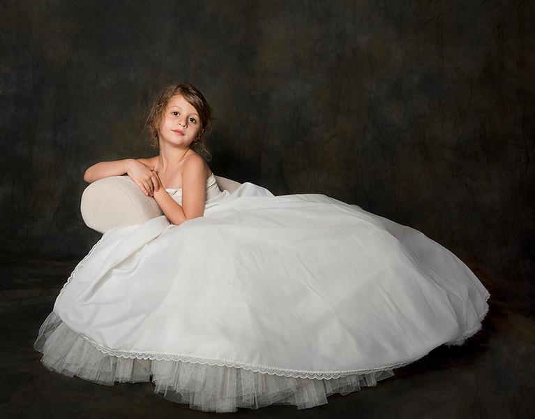 Young girl wearing her mother's wedding pettitcoat