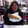 Jane eating Costco dog