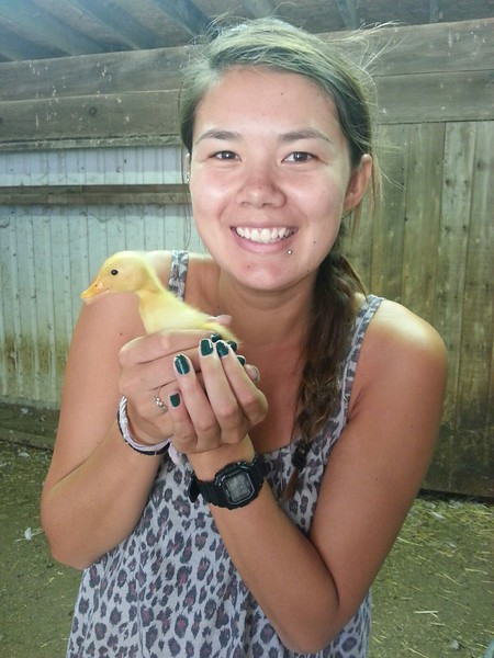 Cindy with baby duck at Windy Acres