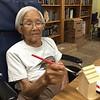 Grandma painting birdhouse