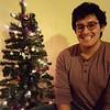 Erick with Christmas tree