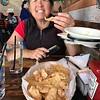 Jane eating chicarones-pork rinds