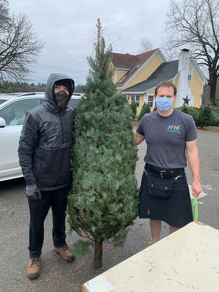 Colin Bedard, left, helps Sean Cooper find the perfect tree. Both ofare from Lowell.