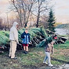 From left, Ryan and Mack Guthrie as Michael makes his maiden voyage, carrying a tree for a customer for the first time.<br /> COURTESY GUTHRIE FAMILY