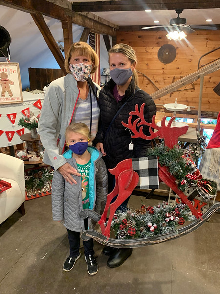 From left, Lil Michalzcyk and Stephanie and Avery Kalitka, all of Dracut, find a perfect Christmas decoration.