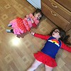 Trying on their new spring clothes from Grandma. Abby insisted on wearing ALL the clothes at once, and Lily thinks the bathing suit looks like a cheerleading outfit.