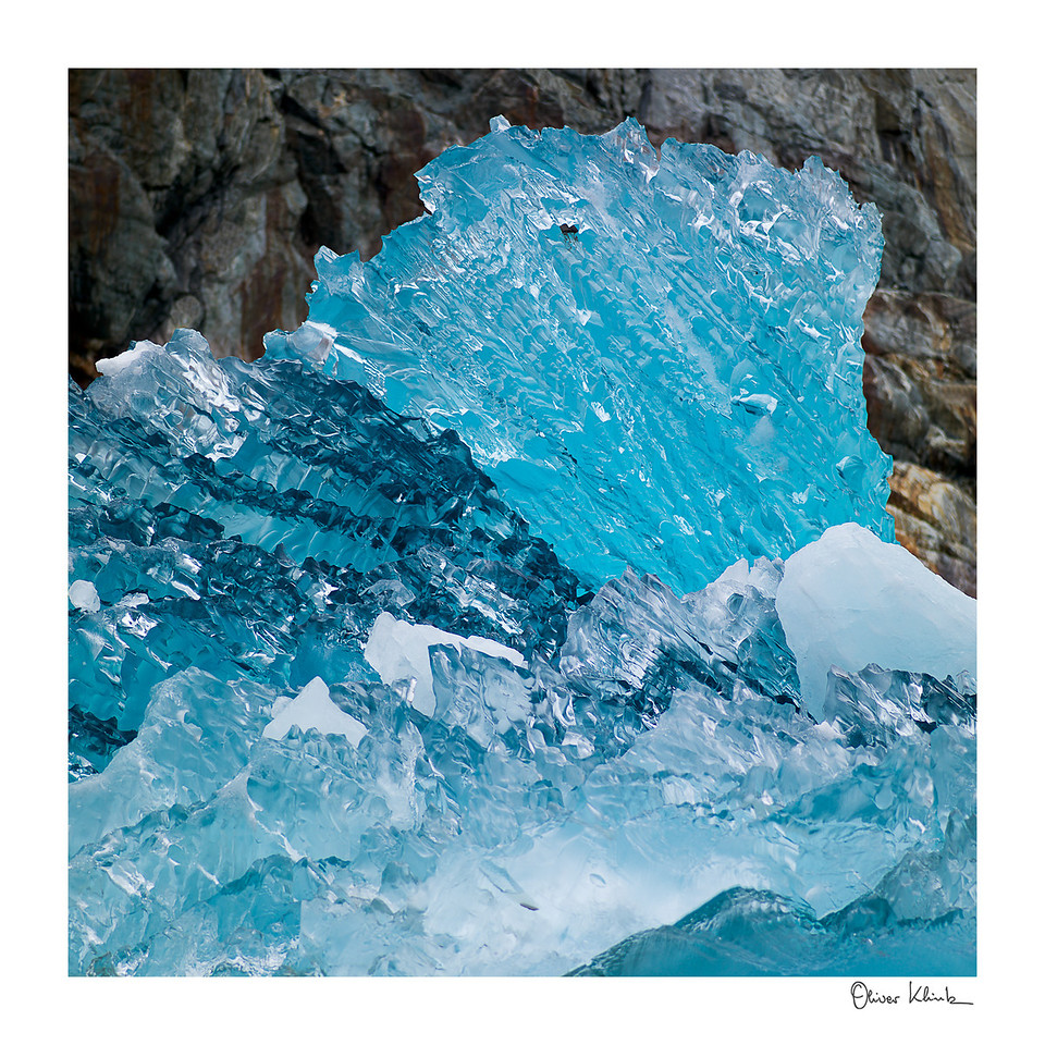 "Title: 	Blue Ice<br /> Location:	Alaska<br /> Size (Framed):	32""x32""<br /> Price:	$600<br /> Description:	I just came off the face of a glacier. Now, I am drifting and melting away. I still look good at 10,000 years old."