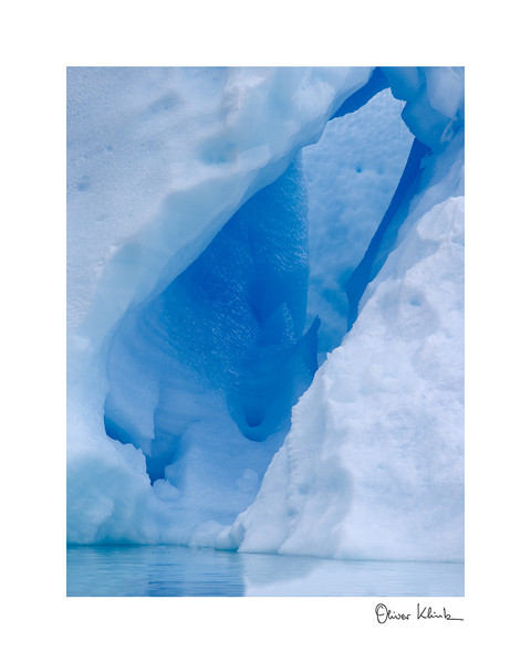 "Title: 	Blue Lagoon<br /> Location:	Iceland<br /> Size (Framed):	11""x9""<br /> Price:	$90<br /> Description:	I am blue, because I am dense. As a floating iceberg, it is a matter of time before I melt down and alter my beautiful shape."