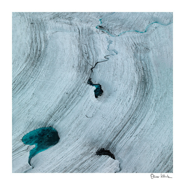 "Title: 	From Above<br /> Location:	Alaska<br /> Size (Framed):	32""x32""<br /> Price:	$600<br /> Description:	I wanted to hide my striking emerald glacier color. In this rough terrain, I am safe and inaccessible. I will grow as the weather is changing."