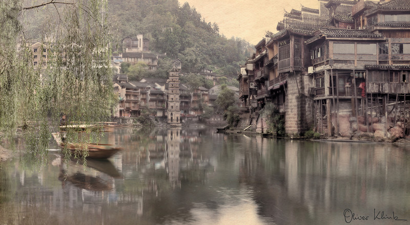 Traditions<br /> <br /> Traditions was photographed in West Hunan, China. The image depicts a wonderful example of what villages were like prior to the onset of modernization. Changes are imminent but local ethnic minorities are trying to hold on to their traditions.