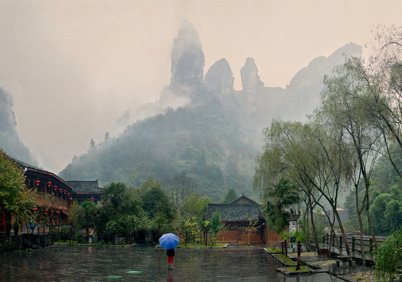 Admiration in the Rain<br /> <br /> Admiration in the Rain was photographed in West Hunan, China. The image depicts a wonderful example of how villagers cherish their land. Changes are imminent but local ethnic minorities are trying to hold on to their traditions.