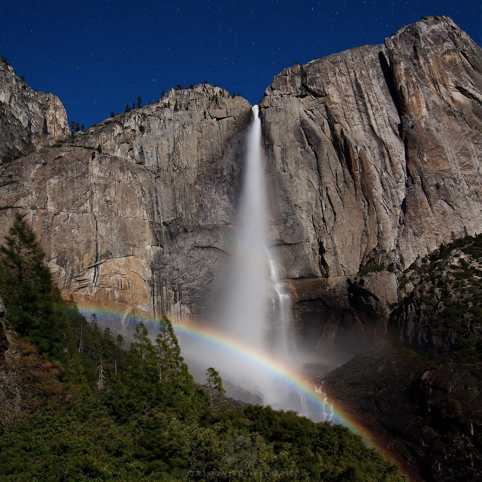 "Upper Falls Lunar Bow - Yosemite National Park, CA <br /> IMG_9033 <br /> <br /> They said that the May 6th 2012 moon was to be a ""super moon."" Well maybe it ""technically"" was but it wasn't near as big as I expected from the pictures I've seen from the 2011 ""super moon."" Either way I manage to capture this amazing scene form the trail to upper yosemite fall. I hiked up that afternoon figuring I would shoot the late afternoon light then wait around for the moon. This turned out to be a bad decision. I had read in the forecast that it would be about fifty that night, well 50 at 6,000ft on an exposed ridge, wind blowing and getting sprayed by mist feels like ice! Not only did I nearly freeze to death but, the lunar bow didn't show up til around 1 AM and I didn't end up hiking out of there until after 2. Meaning that I sat up on the trail for well over 7 hours. Amazingly, however, I only saw one other person after about 7 PM that evening. And this photographer apparently got the ""memo,"" he didn't show up until around midnight. But when all was said and done it was well worth the wait!<br /> <br /> This image will be sold as a limited edition numbered to ""350."""