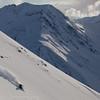 1362 - Skier ripping down the Chugach on a sunny afternoon.  Alaska.
