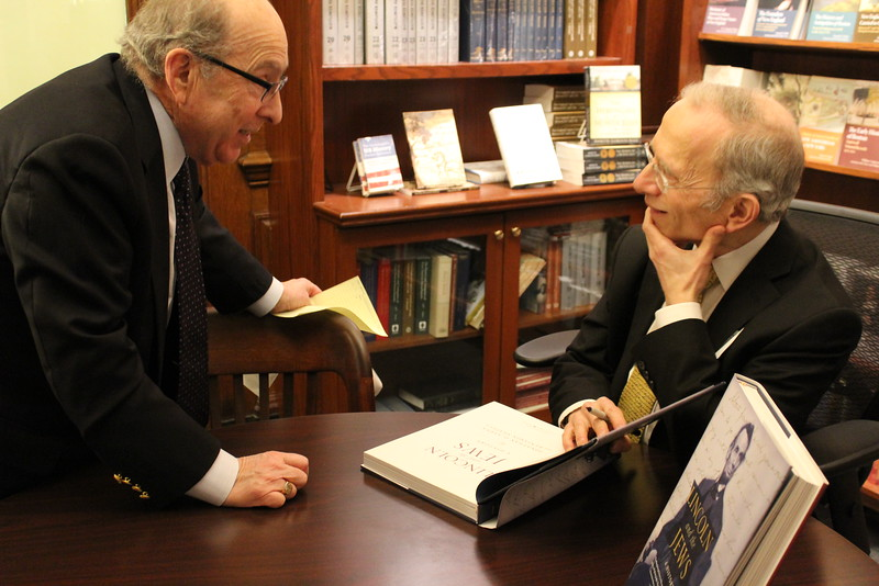 Professor Jonathan Sarna chats with a guest and signs a copy of Lincoln and the Jews