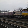 66012 approaches Hillam Gates with 4D27 Milford - Hull empty HTAs on 27th Dec