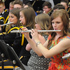 "2005 Teutopolis graduate Angie Willenborg plays the flute with fellow alumni and the Teutopolis High School Band in a performance of ""Jurassic Park"".<br /> Chet Piotrowski Jr. photo/Piotrowski Studios"