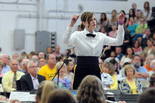 """Senior Julia Greuel conducts the Teutopolis High School Band in a performance of """"The Music of the Night"""" during the Spring Concert.<br /> Chet Piotrowski Jr. photo/Piotrowski Studios"""