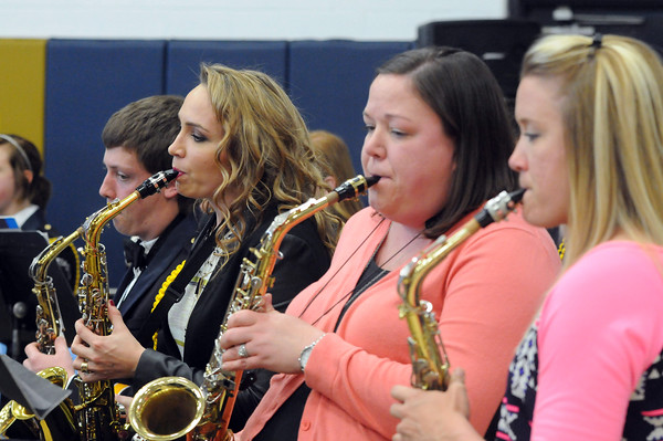 "2002 Teutopolis graduate Lucy Lee plays the alto saxophone with fellow alumni and the Teutopolis High School Band in a performance of ""Jurassic Park"".<br /> Chet Piotrowski Jr. photo/Piotrowski Studios"