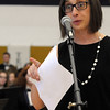 """1996 Teutopolis graduate Suzy Kitten speaks about Craig Lindvahl's positive influence and introduces the Teutopolis High School Band's performance of """"The Mansions of the Lord"""".<br /> Chet Piotrowski Jr. photo/Piotrowski Studios"""
