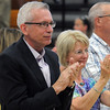 Craig and Beth Lindvahl clap after the performance by alumni and the Teutopolis High School Band.<br /> Chet Piotrowski Jr. photo/Piotrowski Studios