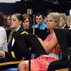 """1992 Teutopolis graduate Nicole Pals rests at attention ready to play the flute with fellow alumni and the Teutopolis High School Band in a performance of """"Jurassic Park"""".<br /> Chet Piotrowski Jr. photo/Piotrowski Studios"""