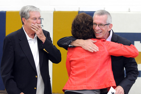 Kim Williams gives Craig Lindvahl a hug as he enters J.H. Griffin Gym for the Spring Concert. At left is her husband Don WIlliams.<br /> Chet Piotrowski Jr. photo/Piotrowski Studios