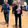 Thursday mornings at the Fitchburg Senior Center you can take line dancing classes with Joyce D'Aguanno of Fitchburg. New dancer Rose Dalessio of Fitchburg tries to learn some steps from D'Aguanno, in blue shirt, as she teaches her class on Jan. 9, 2020. SENTINEL & ENTERPRISE/JOHN LOVE