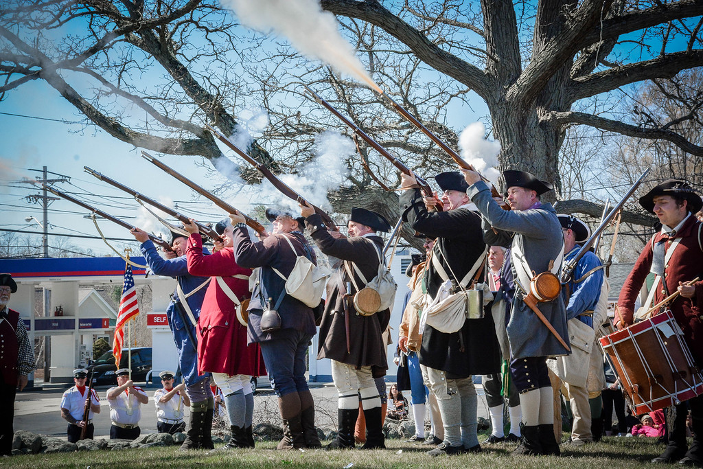 . Shots are fired by reenactos at the Line-of-March dedication in Tewksbury. SUN/Caley McGuane