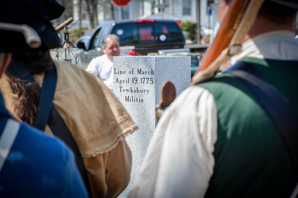 . Reenactors stand in front of the newly placed Line-of-March monuments in Tewksbury. SUN/Caley McGuane