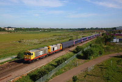 HNRC Railfreight 20118 leads 20132 on 5Q76 0736 Ely MLF Papworth sidings to Newport Docks with ex-GWR HST trailers for scrap at Addenbrooke's, Cambridge south on the Cambridge line on 20 May 2020