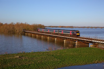 170101 on the 1L38 1122 Birmingham New Street to Cambridge crosses the Hundred foot drain - Ouse Washes at Pymoor south of Manea on the 19th January 2020