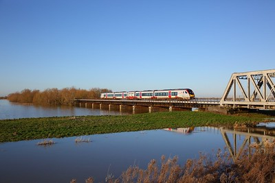 755410 on the 2L77 1354 Peterborough to Ely crosses the Hundred foot drain, Ouse Washes on the 19th January 2020