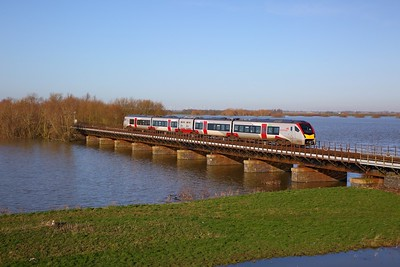 755410 on the 2L75 1147 Peterborough to Ely crosses the Hundred foot drain - Ouse Washes at Pymoor south of Manea on the 19th January 2020