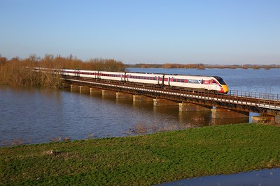 800104 on the diverted 1E09 0900 Edinburgh to London Kings Cross crosses the Hundred foot drain - Ouse Washes at Pymoor south of Manea on the 19th January 2020
