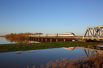 800112 on the 1E11 1030 Edinburgh to London Kings Cross crosses the Hundred foot drain - Ouse Washes at Pymoor south of Manea on the 19th January 2020