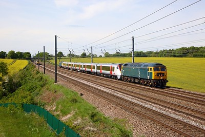 GBRf Caledonian Sleeper 47727 leads Greater Anglia 720515 and 47749 on 5Q20 1100 Derby Litchurch Lane to Ilford EMU depot at Childwickbury south of Harpenden on 18 May 2020