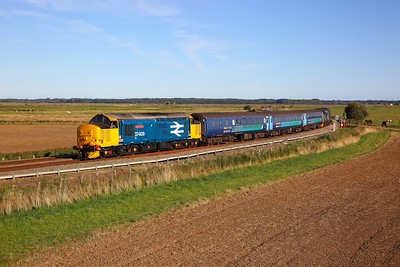 37409 tnt 37423 on the 2J83 1548 Lowestoft to Norwich at Norton Mashes on the approach to Reedham swing bridge on the 24th September 2018