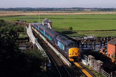 37419 tnt 37425 on the 2J67 0747 Lowestoft to Norwich at Reedham swing bridge on the 3rd August 2015