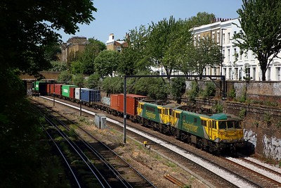 Freightliner Powerhaul liveried cans Nos  86637 leads 86622 on the 4L97 0615 Trafford Park to Felixstowe approaches the site of the former Midlmay Park station on NLL on 21 May 2020