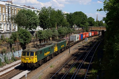 Freightliner 86609 leads the former 86501, no  86608 at Mildmay nearing Canonbury on the NLL with 4M87 1113 Felixstowe North FLT to Trafford Park on 21 May 2020