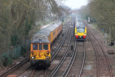 73964+73963 on the 1Q54 Eastleigh to Dollands Moor departing Staines loop as 707003+707005 await with the 5Q61 1410 Clapham Yard to Reading on 16th March 2017