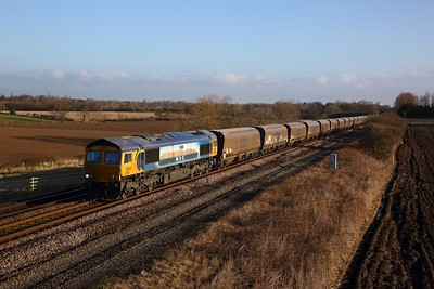 66709 Sorrento is seen passing through Moorhouse Estate Nr Eaglescliffe on the 21st of March 2020, working the 0627 6H12 loaded biomass from Tyne Coal Terminal to Drax