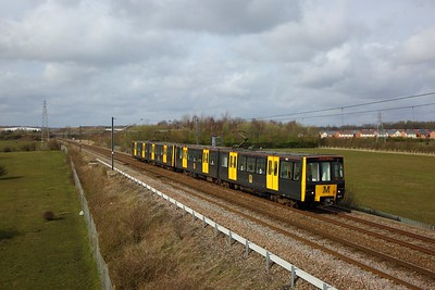 Tyne and Wear Metrocars Nos  4073+4027 arrive at Fellgate with the 2I12 0940 Airport Newcastle to South Hylton on the 21st March 2020