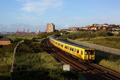 508127 leads 508112 passing Wallasey with 2W24 1953 New Brighton to West Kirby on 19 July 2020