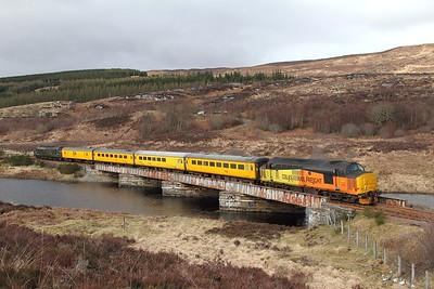 37421 tnt 37057 on the 1Q78 Inverness Millburn to Inverness Millburn via Kyle of Lochalsh at Loch Achanalt on the 16th April 2017