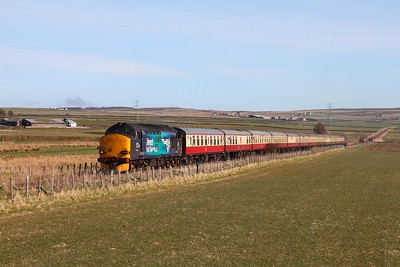 37218+37607 on the 1Z71 0800 Inverness to Wick at Geise near and going to Thurso on the 5th April 2015 1