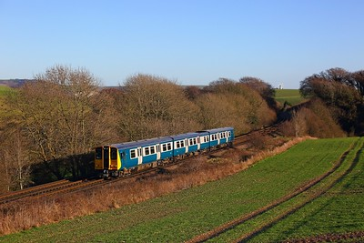 313201 on the 2F62 1257 Seaford to Brighton near Ashcombe Windmill, Kingston just before Falmer on the 28th December 2017